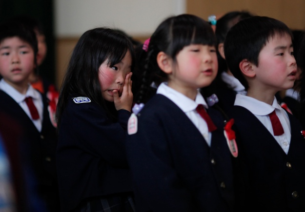 Children attend a graduation ceremony at Ashinome kindergarten in Kessenuma
